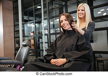 Woman in hairdressing beauty salon
