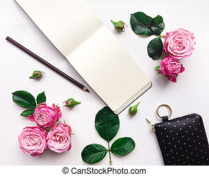 Colorful composition with sketchbook, roses and accessories....