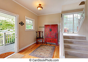 Entry way area in soft tones with staircase, vanity red...