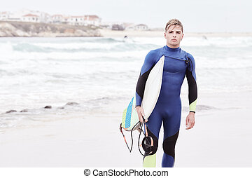 Young surfer on beach - Portrait of young athletic male...