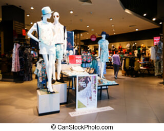 Blur dress store with customers and mannequins