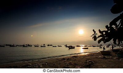Fishing Boats in Sea Bay at Sunset from Beach in Vietnam