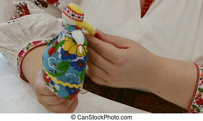 Making Russian handcrafted souvenirs toy on table - Making...