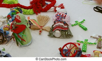Making Russian handcrafted souvenirs toy on table