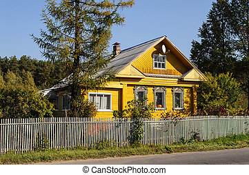 Yellow country wooden house - Yellow wooden house with...