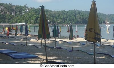 haise longues and sun umbrellas on Phuket Patong beach clip