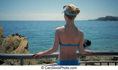 Beautiful girl looking on sea, tourist on vacation perfect...