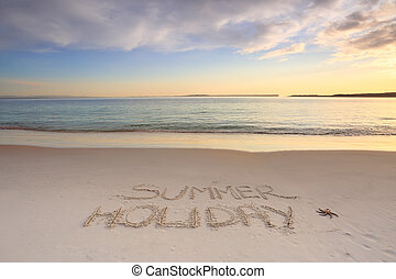Summer Holiday etched into the sand of beach - Summer...