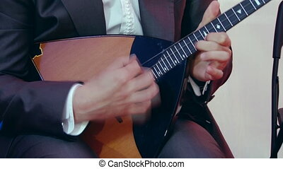 Russian artist playing balalaika, close up - Artist playing...