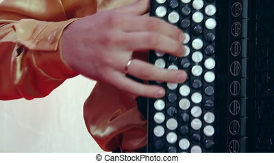 Russian artist playing accordion, close up.