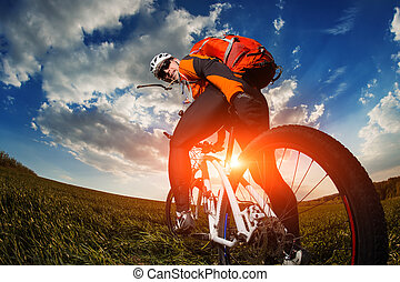 cyclist riding bike on a nature trail in the mountains. -...