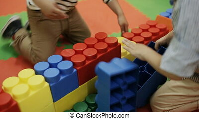children build large Lego blocks - kids build big Lego...