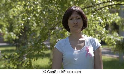 Young woman with pink awareness ribbon - Young brunnete...