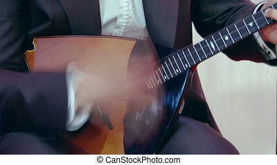 Russian artist playing balalaika, close up. - Artist playing...