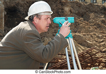 surveyor at construction work