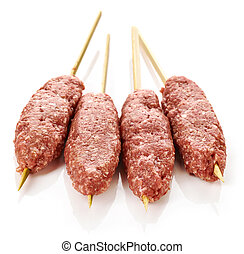 fresh raw minced meat skewers kebabs isolated on white...