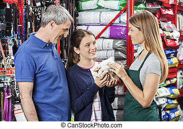 Happy Family Buying Guinea Pig From Saleswoman - Happy girl...