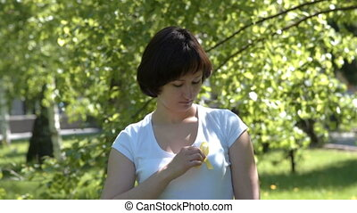 Woman pinning yellow awareness ribbon - Woman pinning yellow...