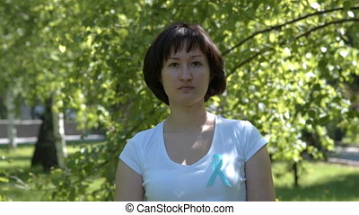 Young woman with teal awareness ribbon - Young woman in...