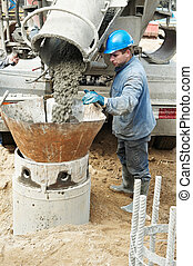 builder at piling construcrion works - construction worker...