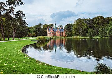 Bath House hunting lodge reflected on pond near...