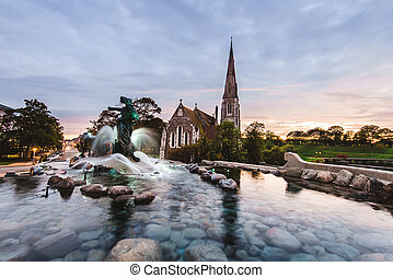 Gefion Fountain and St Albans Church in Copenhagen, Denmark...