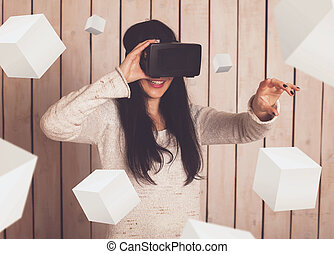 Woman in VR glasses - Woman in virtual reality helmet VR...