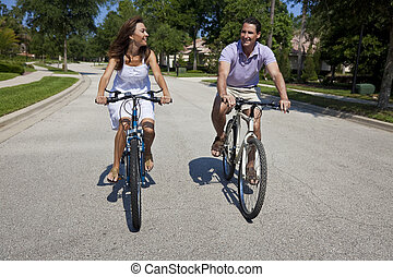 Romantic Man and Woman Couple Cycling Together