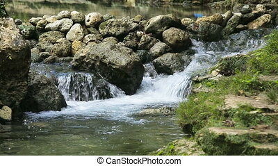 River stream in the tropical forest. - stones and mountain...