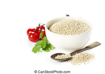 Bowl of healthy white quinoa seeds with vegetables over...