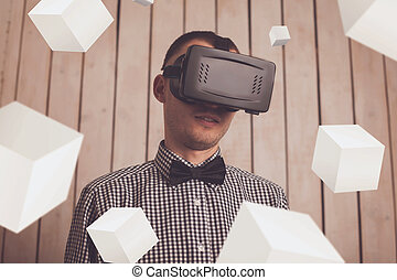 Man in VR glasses - Man in virtual reality helmet for...