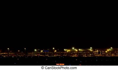 Boeing 777 landing at night - FRANKFURT AM MAIN, GERMANY -...