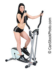 young woman doing exercises on elliptical cross trainer -...