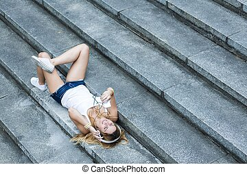 Perfect day to relax - Shot of a happy young woman laying on...