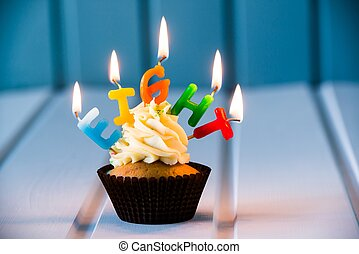 cupcake with a candles for 8 - eighth birthday -...