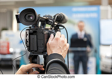 News conference. Spokesman. - Filming press conference with...