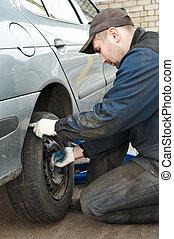 machanic repairman at tyre replacement