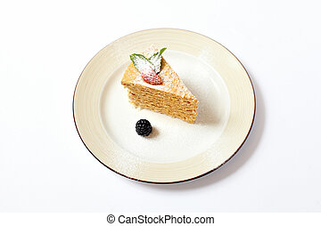 Piece of multilayer cake with powdered sugar and berries...