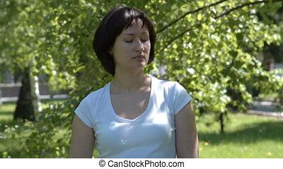 Woman pinning grey awareness ribbon - Woman pinning gray...