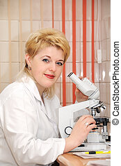 woman medic Scientist and microscope