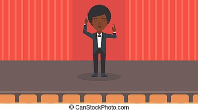 Conductor directing with baton - An african-american woman...