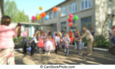 Children release colorful balloons into the sky - Children...