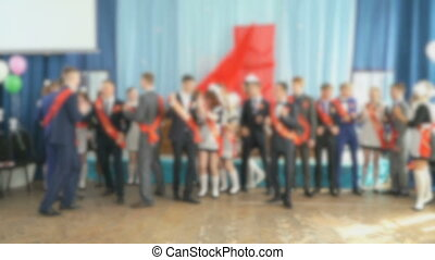 Boys and girls dance in the school's auditorium - Pupils...