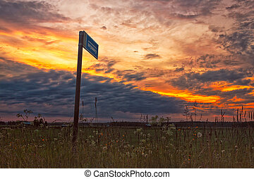 Bus Stop In The Sunset - A lonely bus stop in the middle of...