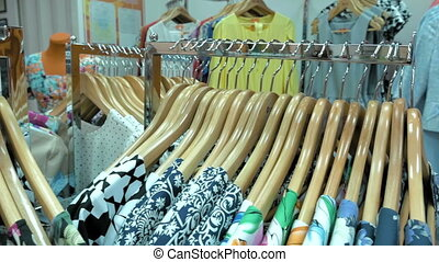 A clothing store is filled with summer garments - A clothing...
