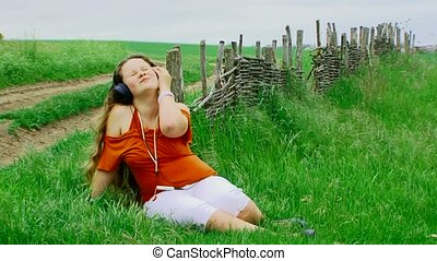 girl listening to music - Happy girl dancing while listen...
