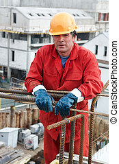 worker builder at construction site - handsome adult worker...