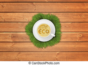 Cup of cappuccino coffee with image ECO symbol on wooden...