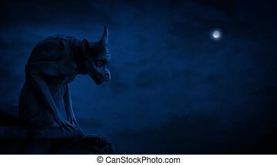 Gargoyle In Moonlight - Stone gargoyle on perch at night...