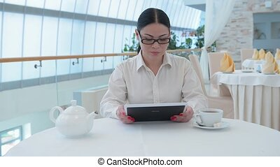 Business woman working on table PC